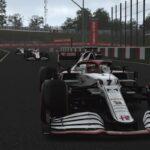 Kimi Räikkönen, Alfa Romeo, devant les Haas à Suzuka